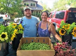 Jason Pluck and Caroline Radice of Potter Valley's Black Dog Farm, shown here at the Willits Farmers Market, received a grant from the Good Farm Fund to purchase irrigation and seed stock for their 2016 farming season.